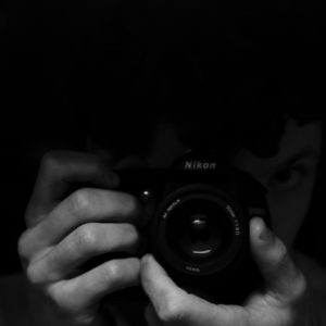 An eye and hand extension black and white camera nikon